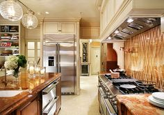 This kitchen and pantry were outfitted for entertaining with Electrolux ranges, 2 warming drawers, a glass-front wine cooler, and 42-inch-wide side-by-side stainless steel refrigerator.