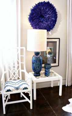 LOVE the feathered piece on the wall and the bespoke fretwork chair by William-Christopher Design.