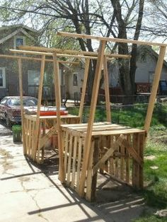 I built these two garden tables for 20 dollars from free palets and 2x4s from the scrap yard.  I will put potted garden plants on them and hanging strawberries and cat nip from the hangers. -- yup my hubby is awesome!! :)
