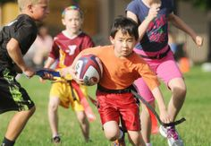 Ethan Fung, 8, of Eagle, tries to outrun the competition during the Thursday evening Rookie Rugby Summer Program scrimmage at Mountain View High School in Meridian. The Rugby Idaho camp is open for boys and girls in grades 1-8.