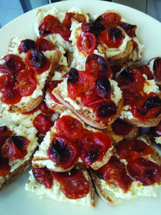 Bruschetta with ricotta and lemon and caramelized cherry tomatoes