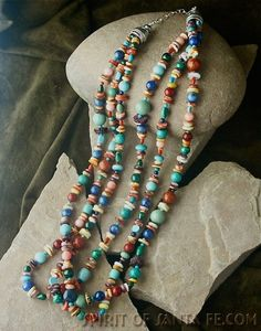 Triple strand 24 inch long multi-color turquoise, coral, lapis, oyster shell, gaspeite necklace from our Collection of Authentic Native American handcrafted jewelry.  $599.00