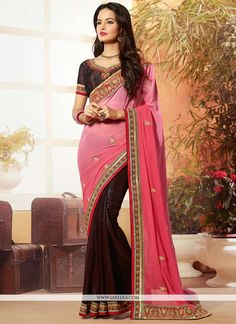 Brown and pink georgette satin designer saree designed with embroidery, zari, resham, lace and patch border work. As shown row silk blouse fabric is available and the same can be customized in your st...