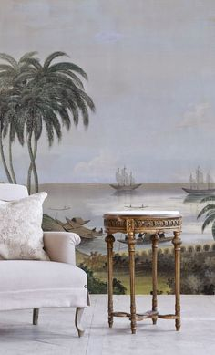 "A vintage tropical painting with palm trees and ships wallpaper mural accent wall makes a bold statement in an elegant traditional living room. This mural would also look great in an entryway or dining room - Unique Living Room Ideas & Decor - ""India,"" a contemporary wallpaper mural, copied or inspired by antique originals by Ananbo wallpaper manufacturers in Bordeaux, France"