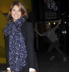 Who's that guy? While Gemma Arterton smiled for the cameras, an overeager fan photobombed ...