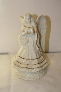 "Porcelain angel with gold trim holding a bird figurine $15 measures approx: 9"" x 5 1/4""D"