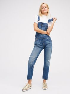 Levi's Heritage Overall | Classic denim overalls from Levi's featured in a slouchy fit with a slight tapered ankle. Pocket detail on the bib and distressing detailing on the knee. Five-pocket style with adjustable straps.