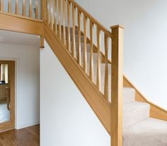 This elegant twisted spindle staircase was expertly handcrafted by master carpenters and features our Eden spindles and Cherwell newel posts. Timber Staircase, New Staircase, Staircase Ideas, Hallway Ideas, Staircase Design, Bespoke Staircases, Hallway Storage, Banisters, Loft Design