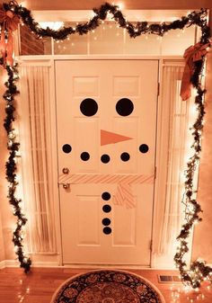 #Holidays adorable snowman door! Cute for Christmas party's or get-togethers. The lights were a nice touch.. They really just make the picture. (: