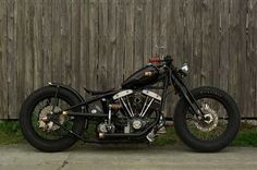 This s a sweet old school Harley-Davidson bobber motorcycle with some really nice accent tips on the exhaust tips.