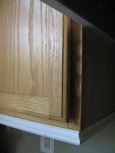 Remodelando la Casa: Adding Moldings to your Kitchen Cabinets.... Love the moulding at the bottom of the cabinets!!