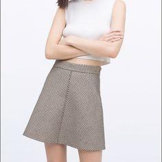 Zara A-Line Jacquard Skirt Chic Zara A-line work skirt. Beautiful quality. Light blue, cream, and black threads. Zips on side. Zara Skirts A-Line or Full