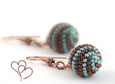 Beaded Bead earrings Turquoise & Chocolate Copper Earring Hooks  Bali-style  Turquoise  Brown Copper Minimalist Modern Beadwork. $19.50, via Etsy.