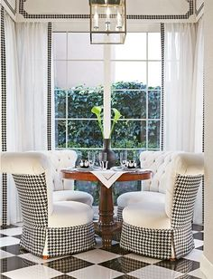 *Black and white flooring window treatments and darling white chairs with backs and skirts in black and white gingham. I kind of LOVE this!!!
