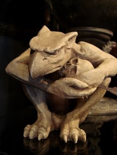 Gothic Gargoyle Holding Skull....I had a little version of him, where did he go...hum...