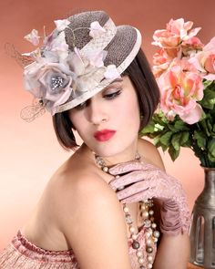 Open weave straw hat with chiffon rose, vintage leaves & veiling