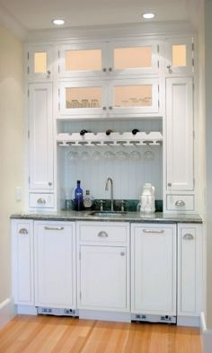 Wet bar wine glass rack and coolers.