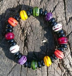 Check out this item in my Etsy shop https://www.etsy.com/uk/listing/275399020/colour-brights-and-black-beaded