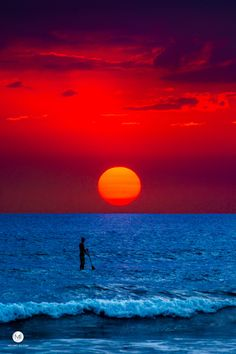 SUP Sunset - SUP dude staring at the amazing sunset at Playa Guiones, Guanacaste, Costa Rica