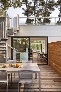 """Bright Renovation of a 1970s Big Sur Home - Photo 1 of 10 - The house is set on a forested hill, which means the backyard—though scenic—is too steep to enjoy. It's also perpetually shady. Schicketanz wanted somewhere she could soak in the sun, so she added a roof deck. """"It's really the only usable, large outdoor space I have,"""" she says."""