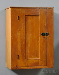 Shaker Pine Hanging Wall Cupboard, Mt. Lebanon, New York, c. 1840-50, the case with paneled door opening to one shelf, old refinish, ht. 25, wd. 18 1/2, dp. 12 1/4 in.
