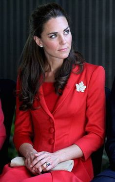 Duchess looking radiant in red while on their 1st travel to Canada. Notice the Canadian pendent.