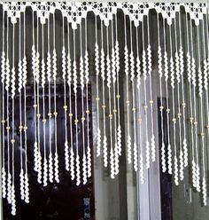 Make a sweet room divider of curtain fringe