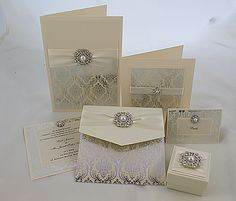 Vintage style wedding stationery in cream and silver with pearl embellishment