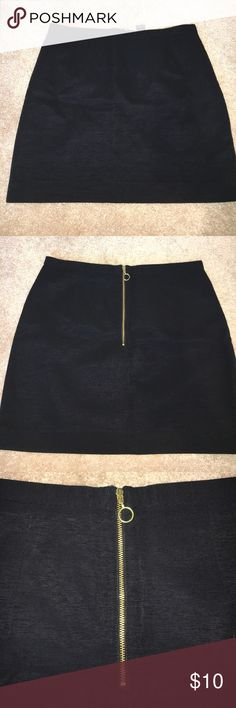 H&M Black Ribbed Mini Skirt US 6 Very small. Doesn't fit like a true 6...more like a 2. I wear a 0 in J.Crew and Gap skirts just to help with sizing! Short. Gold zip closure detail. Black lining. H&M Skirts Mini