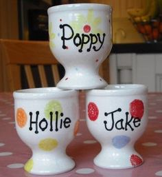 Personalised, hand painted pottery egg cups.