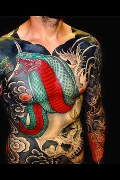Cobra and Skull tattoo chest piece and sleeves