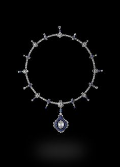 Carnet Sapphire Belle Necklace Fancy light yellow and white diamond and blue sapphire necklace set in platinum & titanium.