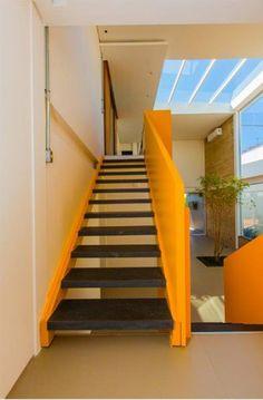 YTA architects: KR residence's geometric yellow ribbon