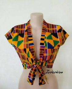 A classic African crop top . Look smart and flashy in this beautiful African crop top for that special occasion. A classic African crop top . Look smart and flashy in this beautiful African crop top for that special occasion. African Fashion Ankara, Latest African Fashion Dresses, African Print Dresses, African Dresses For Women, African Print Fashion, Africa Fashion, African Attire, African Tops For Women, Tribal Fashion