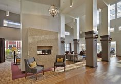 The hotel-like grand lobby features vaulted ceilings, a double-sided fireplace, and a variety of conversation areas. Coopers Hall, Conversation Area, Assisted Living Facility, Double Sided Fireplace, Senior Center, Healthcare Design, Senior Living, Hotel Lobby, Evergreen