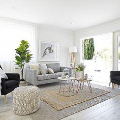 A calming living room designed by Three Bird Renovations. We see our White Oak Laminite Flooring peeking through! #texture #flooring #layers