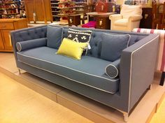 Love this style of sofa - firm, low and long, with lots of cushions. Also love the colour and piping detail!  TKMaxx / Homesense
