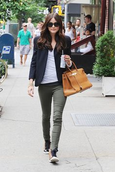 Olivia Palermo ... Using the perfect contradiction of accessories.