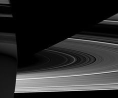 Oct 2010 Saturn: Light, Dark, & Strange Credit: Cassini Imaging Team, ISS, JPL, ESA, NASA That large orb on the left must be Saturn itself. Those arcs on the right are surely the rings. The dark band running diagonally must be the shadow of Saturn on the rings. That leaves the unusual dark bands superposed on Saturn's disk -- are they the shadows of the rings? ... So the rings themselves cause the dark streaks on Saturn. These rings segments appear dark because they are in the shadow of…