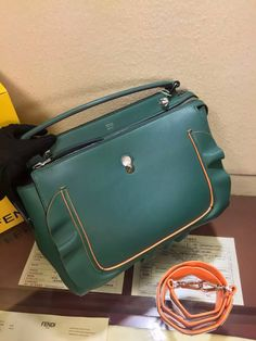 f2a4b8fd87f5 Fendi DotCom Fashion Show handbag dark green calfskin two compartments  fastened a zip divided by partition