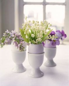 Flower Arrangements in Eggshells  Hollowed-out eggshells make naturally beautiful vases for tiny flower arrangements.