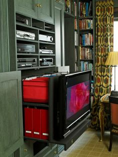 "Previous pinner: ""'Elegant Rooms that Work' by Stephanie Stokes - library / guest room / office - beautiful storage solutions"" -- SH: ""The television is attached to a pull-out unit that stores work files and project binders."" -- See this room with the television hidden here: http://www.architecturaldigest.com/ad/books/2013/stephanie-stokes-book-elegant-rooms-that-work-slideshow_slideshow_item2_3 & as guest room here: https://uk.pinterest.com/pin/529806343639772902/"