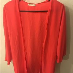 Coral Short Sleeve Cardigan Lightweight coral short sleeve cardigan. Perfect for layering. 100% Polyester. Price is firm unless bundled. Please note that while this item is retail and never worn it does not have a tag. Boutique Tops