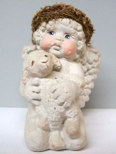 Angel cherub Dreamsicles Cast Art Hand Crafted Art Lamb Knick knack home deco $42.60. Spring and Summer accessorizing is very important for Your Personal Brand! Island Heat Products www.islandheat.com today's clothing Fashions and Home Goods with Great Family Gift Idea's. Shop Island Heat on eBay and Bonanza for Great Deals and same day shipping!