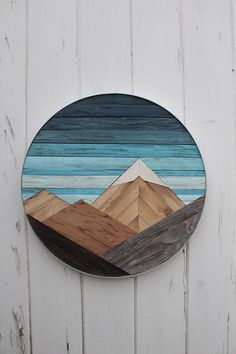 This reclaimed wooden mountain range is made with cedar fencing, pallet wood, and lath. It is trimmed in aluminum.