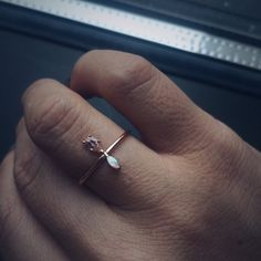 This delicate ring pairs together a prong set morganite stone with a prong set…