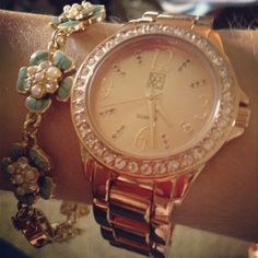 Mint bracelet and rose gold watch.