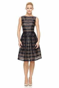 ac61a985f8 The horizontal stripes on this little black dress add to its overall  appeal