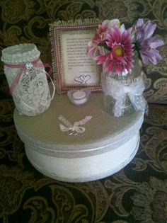 Cheese boxes I made with burlap, lace, ribbon, paint,tulle with glitter dots over white paint. Lace wrapped mason jars. Decorated pic frame with Love is..verses, mason jar flower vase,heart votive holder & 2 rings tied with lace.