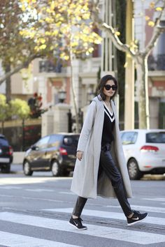Fuck Yeah Street Style, fall winter, sunglasses, beige coat, black sweater, black leather pants, black nike sneakers